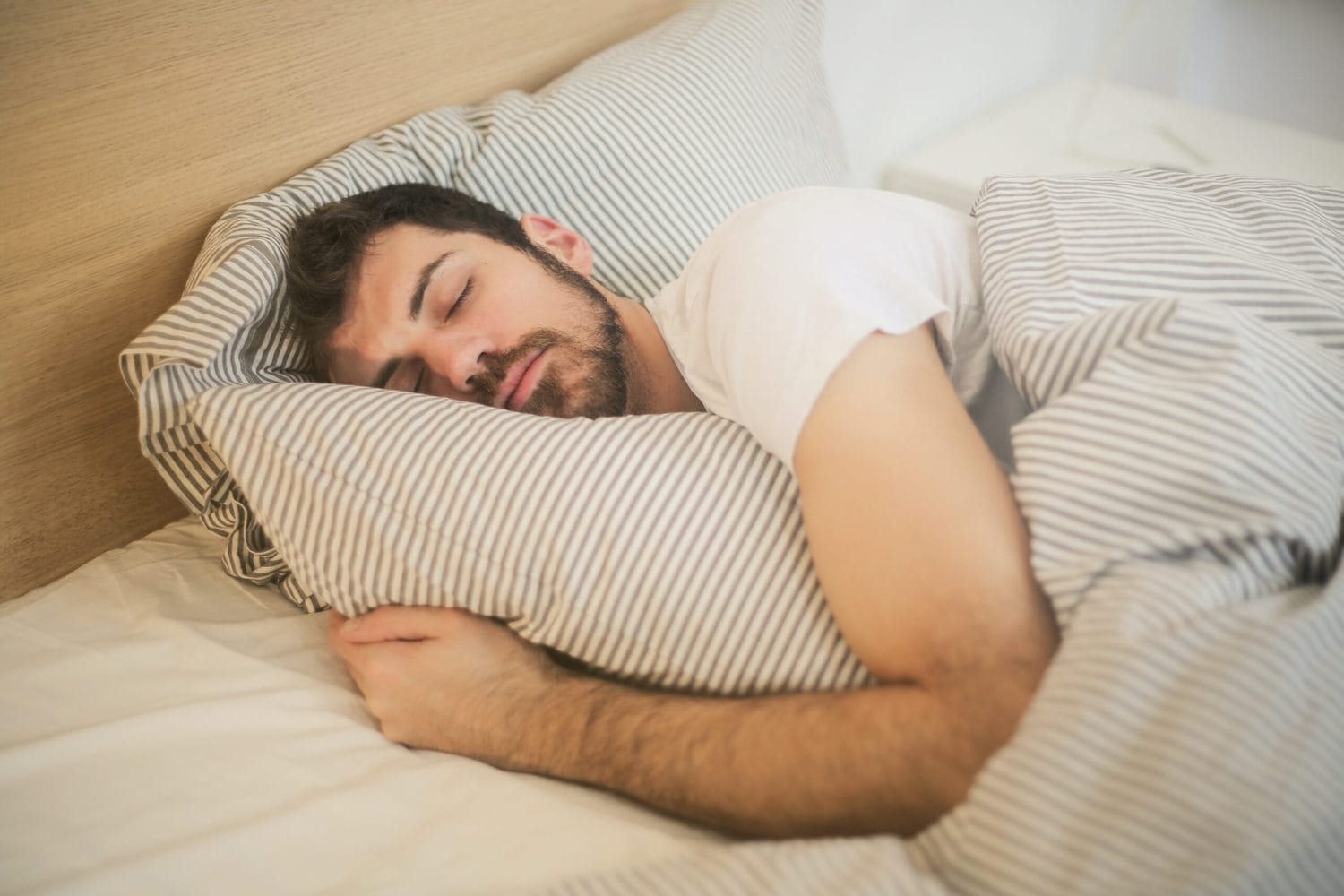 man sleeps better after quitting alcohol
