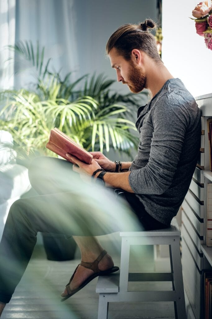 A man reading a book.